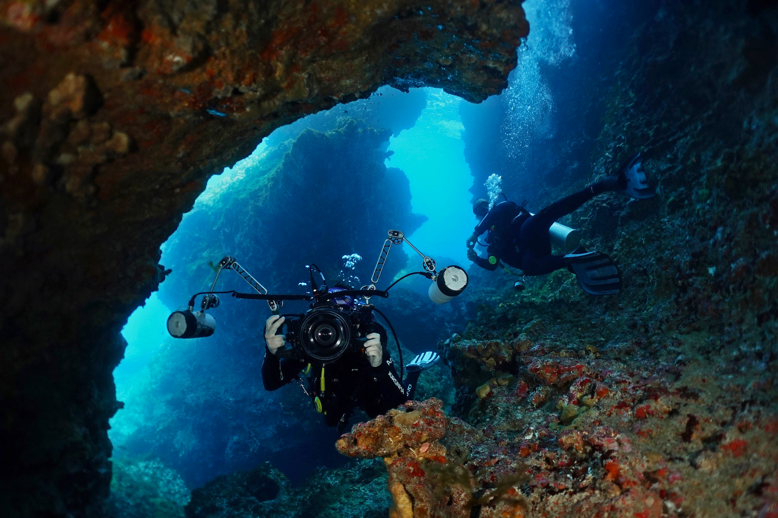 Divers in a cave at Ilha do Meio. Photo by Pierre Constant